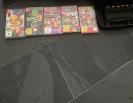 Nintendo switch spiele inkl tasche
