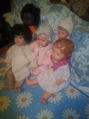 5 Puppen