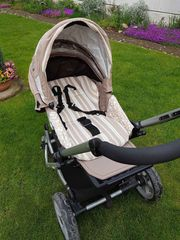 Kinderwagen mit Babyeisatz