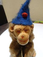 Affe mit Schellen