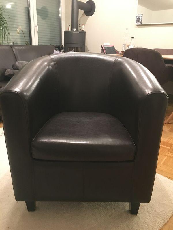gut erhaltener schwarzer Sessel 70