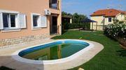 Ferienwohnung mit Pool und Garten