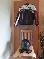 Motorradjacke Helm und Handschuhe