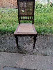 Antiker Stuhl mit Geflecht