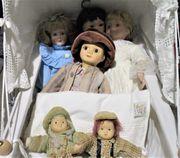 nostalgischer hoher Puppenwagen mit Kissen