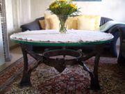 Wohnzimmer Glastisch mit schmiedeeisernem Fuss