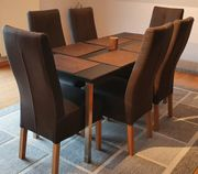 Esstisch mit vier silberfarbenen Tischbeinen