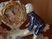 Porzellanfiguren mit Uhr