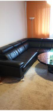 Wohnungsauflösung schwarze Ledercouch 1 Jahr