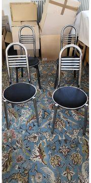 4 neuwertige Stühle