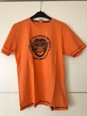 Orangenes T-Shirt Trigema mit Affendruck