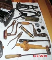 Konglomerat von alten Werkzeugen Fotoapp