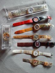 8 ältere Swatch Uhren
