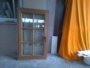 Gebrauchtes Holzfenster mit Sprossen zu