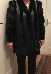 Damen-Pelzmantel schwarz Gr 44