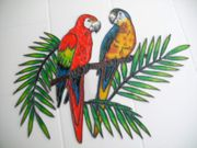 Papageienpaar auf einem Ast