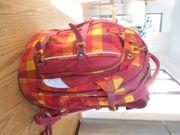 Satch Pack Schulrucksack in rot-orange-gelb
