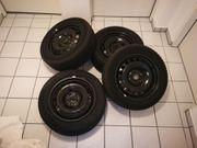 4 Dunlop-Winterreifen inkl Radkappen für