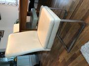 Stuhl aus Edelstahl und Leder