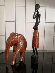 Elefant und afrikanische Figur