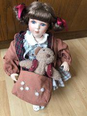 Verschenke Porzellan Puppe mit Koffer