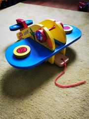 Holzflugzeug zusammensteckbar mit Rollen