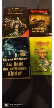 Verschieden Bücher sowie ein Kinderbuch