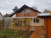 1 Familienhaus mit schönem Garten