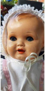 antikes Puppen-Kind mit Schlaf-Augen