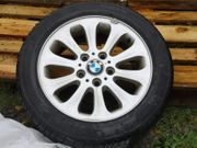 4 Winterreifen auf Original BMW-