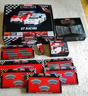 Carrerabahn Evolution mit 8 Rennwagen