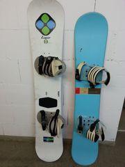 Weißes Snowboard mit Zubehör
