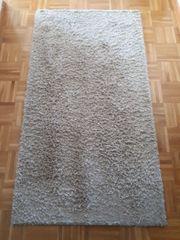 Beiger Shaggy Teppich