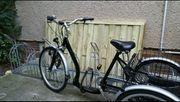 Senioren fahrrad mit dreirad und