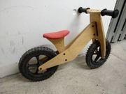 Laufrad aus Holz günstig zu