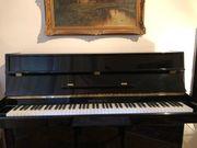 Klavier schwarz lackiert