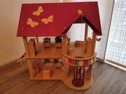Haba Puppenhaus mit Spielplatz und