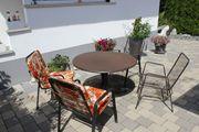 Gartentisch rund mit Gartenstühlen