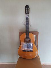 Gitarre mit neuen Saiten