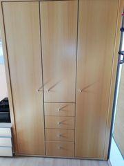 Kleiderschrank Schreibtisch und Container für