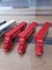 Drei LKW Coca Cola zum
