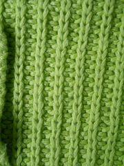 Grüner Pullover in der Größe