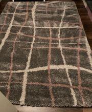 Teppich hochflor grau rosa weiß
