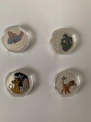 Verschiedene Disney Münzen