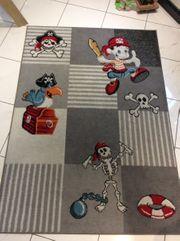 Kinderteppich Pirat grau