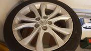 Mazda Alufelgen mit gebrauchten Sommerreifen