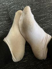 Fitnesstrainerin verkauft ihre getragenen Socken