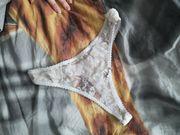 Saftiger getragener Stringtanga