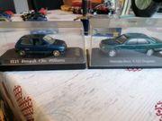 Mercedes E 320 und Megane
