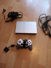 PlayStation 2 Slim Silber